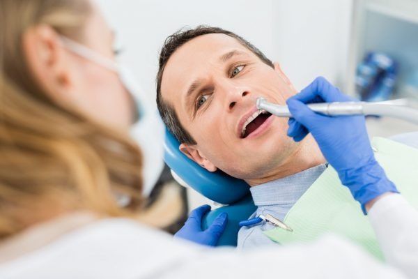 male-patient-at-dental-procedure-using-dental-dril-VWUTEQM-1-scaled.jpg